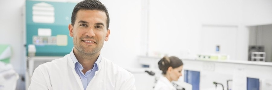 smiling_young_pharmacist_in_lab